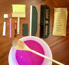 Tools from the wallpaper kit plus the paste mixed with water ready to go.